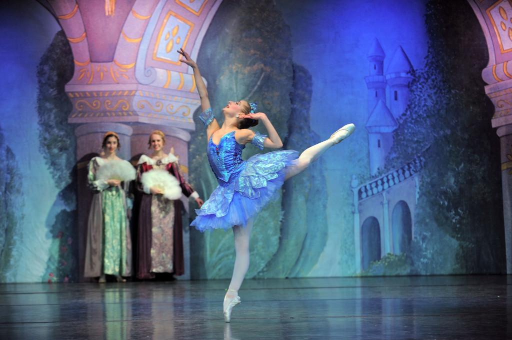 Female ballet dancer on stage w/ blue costume